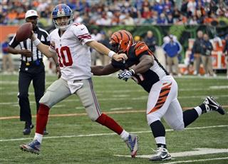 Eli Manning, Geno Atkins
