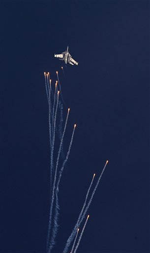 Indian Air Force Sukhoi Su-30 MKI fires flares during a Vertical Charlie maneuver at the Air Force Day parade at Hindon Air Force base near New Delhi, India, Thursday, Oct. 8, 2015. Air Chief Marshal Arup Raha announced Thursday that the IAF would have women fighter pilots, a proposal pending at the Indian Defense Ministry for approval.