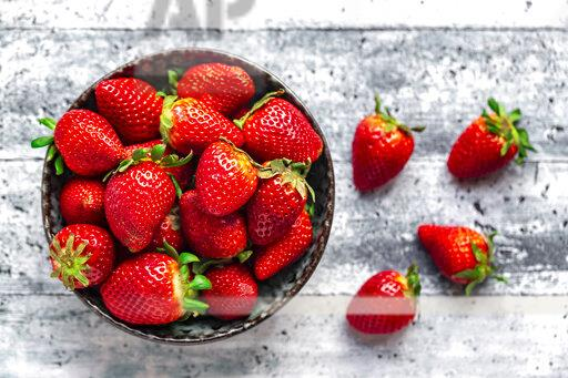 Bowl with fresh strawberries