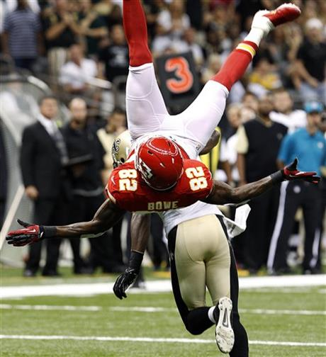 Bowe 82 is upended by new orleans saints cornerback patrick robinson