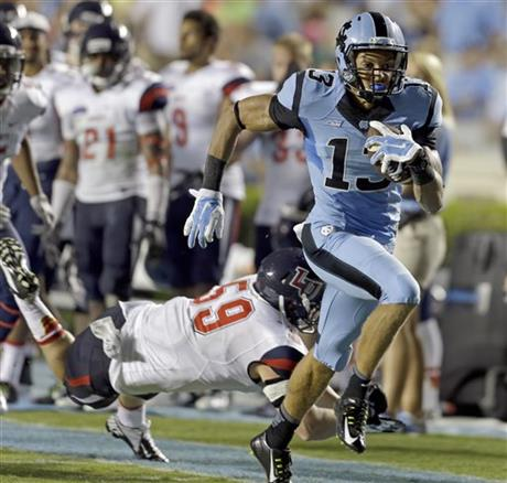 North carolinas ryan switzer (3) runs for a touchdown against duke as mack hollins reacts in the background during