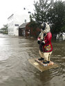 In this photo released by the City of New Bern, N.C., a bear statue floats in flood waters on South Front street in New Bern, N.C. on Friday, Sept. 14, 2018. Hurricane Florence lumbered ashore in North Carolina with howling 90 mph winds and terrifying storm surge early Friday, ripping apart buildings and knocking out power to a half-million homes and businesses as it settled in for what could be a long and extraordinarily destructive drenching. (City of New Bern via AP)