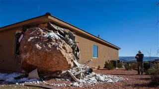 BOULDER HITS HOUSE