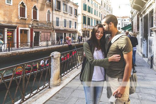 Italy, Venice, affectionate young couple in the city