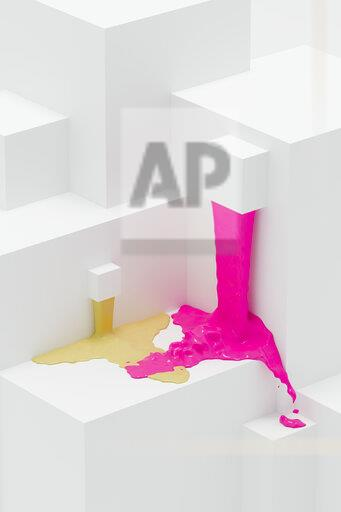 Pink and yellow paint flowing on abstract 3d angular shapes