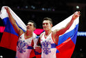 Gold medal winner on the parallel bars, Artur Dalaloyan of Russia, left, and silver medal winner David Belyavskiy of Russia celebrate during the men's artistic gymnastics finals at the European Championships in Glasgow, Scotland, Sunday, Aug. 12, 2018. (AP Photo/Darko Bandic)