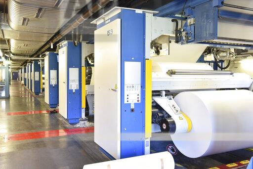 Printing shop: paper roll in a printing press