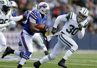 LaRon Landry, C.J. Spiller