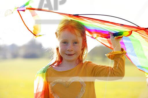 Portrait of redheaded girl holding a kite