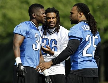 Kevin Smith, Louis Delmas, Mikel Leshoure