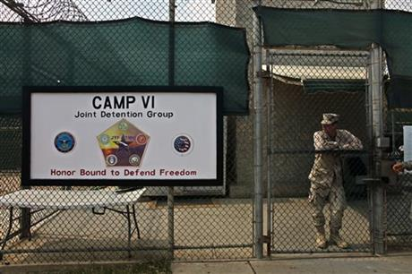 A soldier stands guard at the front gate entrance to Guantanamo's Camp 6 maximum-security detention facility