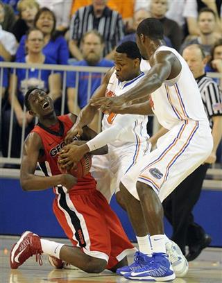 Brandon Morris, Michael Frazier II, Patric Young