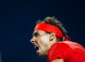 Rafael Nadal, of Spain, serves the ball against Stan Wawrinka, of Switzerland, during the Rogers Cup mens tennis tournament Thursday, Aug. 9, 2018, in Toronto. (Nathan Denette/The Canadian Press via AP)