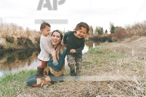 Mother and her children enjoying nature