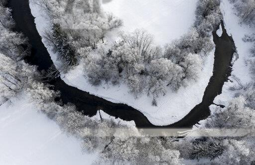 Tree at Loisach river, Aerial view of river loop in winter