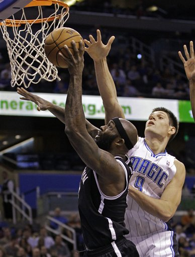 Nikola Vucevic, Reggie Evans