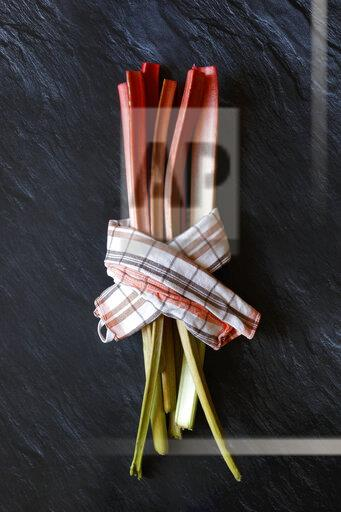 Rhubarb stalks and kitchen towel
