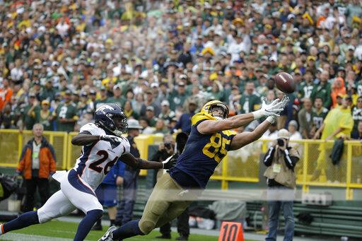 Broncos Packers Football
