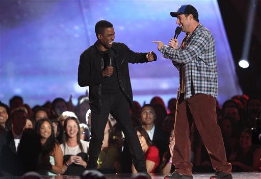 Actors adam sandler right and chris rock present the award for best