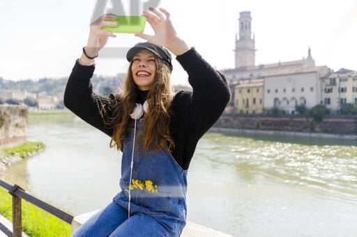 Young woman using smartphone in Verona