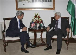 Palestinian President Mahmoud Abbas (R) meets with U.S. Secretary of State John Kerry  in the West Bank city of Ramallah