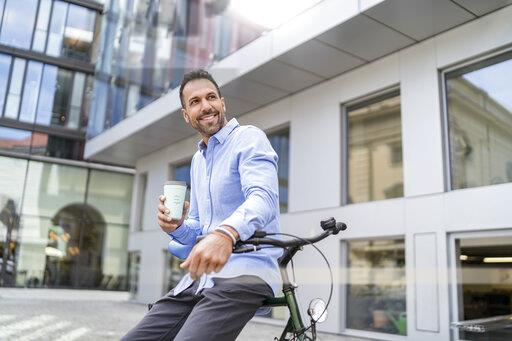 Businessman with bicycle in the city