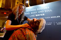 Kelly Hawe, left, Spa Lead-Esthetics at the Kohler Waters Spa, in Kohler, Wisc., applies a massage at the annual International Spa Association event, in New York, Tuesday, Aug. 7, 2018. (AP Photo/Richard Drew)