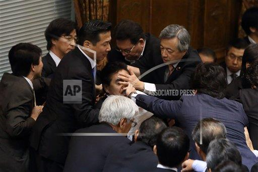 REX AP     5092459a Fighting breaks out among lawmakers as controversial security bill approved, Tokyo, Japan  - 17 Sep 2015
