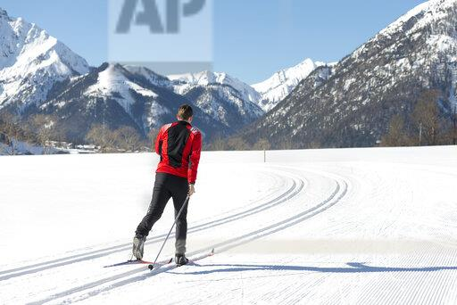 Austria, Tyrol, Achensee, man doing cross country skiing