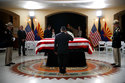 A serviceman salutes as he pays his respects at the casket of Sen. John McCain, R-Ariz. during a memorial service at the Arizona Capitol on Wednesday, Aug. 29, 2018, in Phoenix. (AP Photo/Jae C. Hong, Pool)