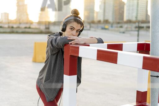 Sportive young woman with headphones during workout