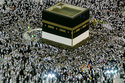 Muslim pilgrims circumambulate around the Kaaba in the Grand Mosque, before leaving for the annual Hajj pilgrimage in the Muslim holy city of Mecca, Saudi Arabia, early Sunday, Aug. 19, 2018. The annual Islamic pilgrimage draws millions of visitors each year, making it the largest yearly gathering of people in the world. (AP Photo/Dar Yasin)