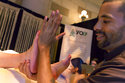 Massage Therapist Lenny Fore, from YO1 Luxury Nature Cure, in Monticello, N.Y., demonstrates a foot massage at the annual International Spa Association event, in New York, Tuesday, Aug. 7, 2018. (AP Photo/Richard Drew)