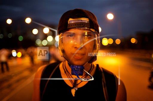 Venezuela Masked Protesters Photo Gallery
