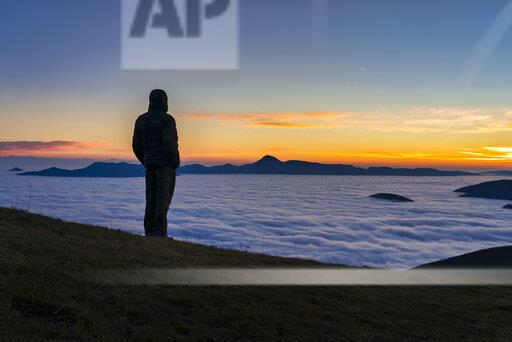 Italy, Marche, Apennines, Mount San Vicino at dawn seen from mount Cucco