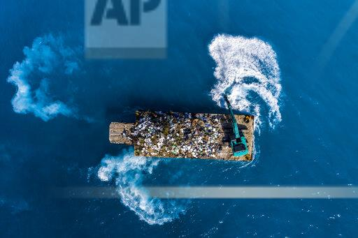 Maledives, South-Male-Atoll, plastic waste disposal with digger from above