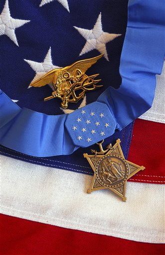 Creative AP Photo/Stocktrek Images A Military Washington USA vertical The Medal of Honor rests on a flag beside a SEAL trident.