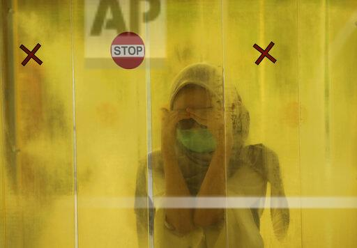APTOPIX Virus Outbreak Indonesia