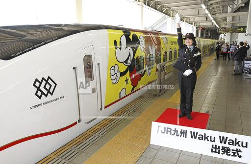 Mickey Mouse Bullet Train travels Southern Japan