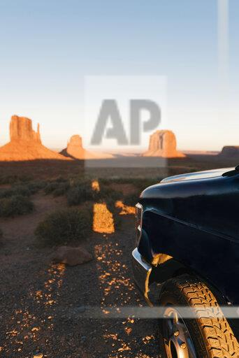 USA, Utah, Monument Valley, jeep at sunset