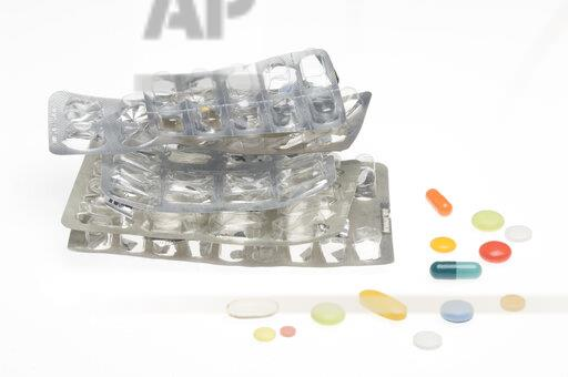 Empty blister pack and colourful pills