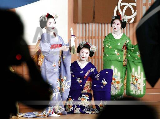 Kyoto's maiko prepare for stage performance