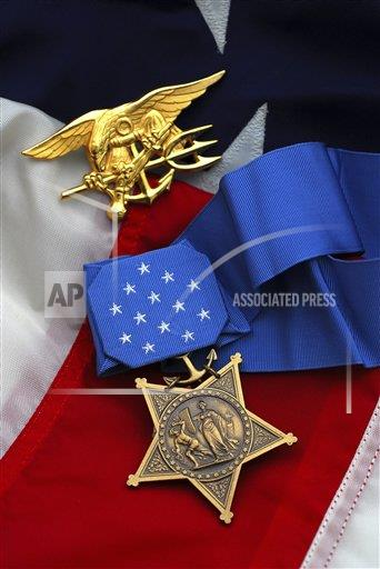 Creative AP T  Washington D  vertical Close-up of the Medal of Honor award and American flag.