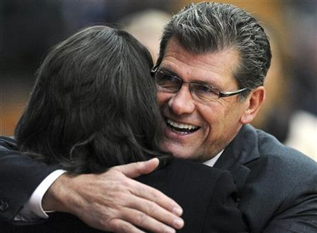 Connecticut head coach geno auriemma, right, hugs hartford head coach