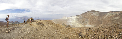 Aeolian Islands, Vulcano, Panoramic view from volcano, Gran Cratere, hikers at volcanic crater