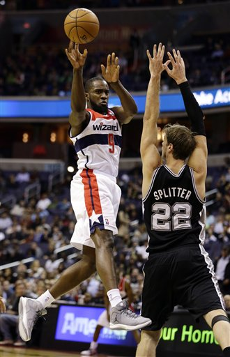 Martell Webster (9) passes the ball in front of San Antonio Spurs forward Tiago Splitter