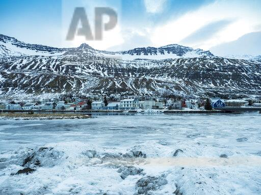 Iceland, Fjardara, the seal resting place with mountains of the it in winter with ice and snow