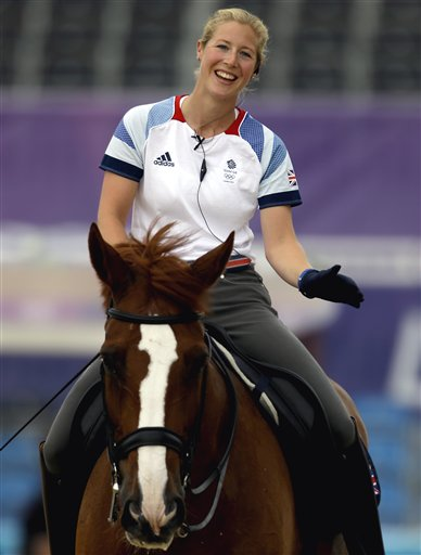 Laura Bechtolsheimer, of Great Britain, rides Mistral Hojris, during a