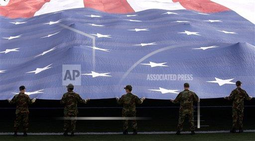 Creative AP T    horizontal Airmen present the American Flag during the National Anthem.