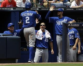 Alcides Escobar, Ned Yost, left, George Kottaras, James Shields